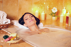 Add essential oils to your bath for a blissful experience . . .