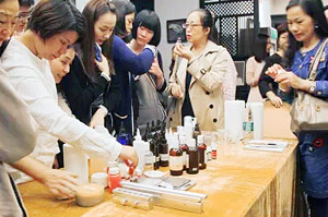 Students making aromatherapy products during the ground floor workshop